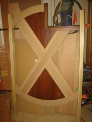 Center panel glued up and set aside with posts for safe-keeping