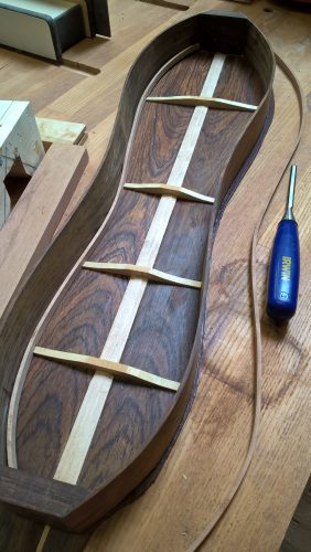 Back braced and glued to sides. Installing the cherry lining.