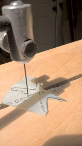 Cutting out the star with a jewel's saw