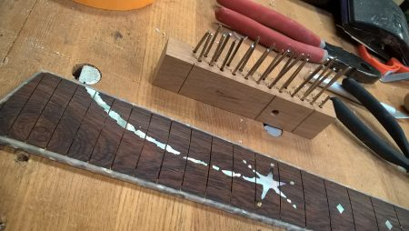 Preparing to fret the fingerboard