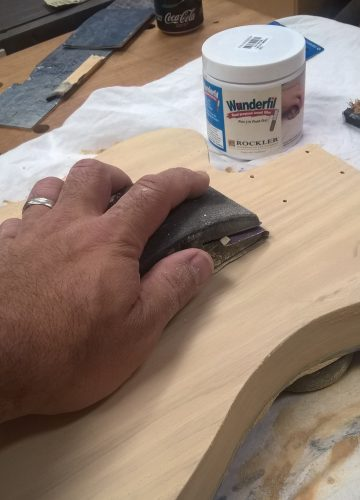 Sanding the grain fill